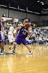 30 December 2006: Drew Yancey protects his possession. The Titans outscored the Britons by a score of 94-80. The Britons of Albion College visited the Illinois Wesleyan Titans at the Shirk Center in Bloomington Illinois.<br />