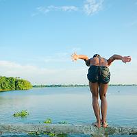 Boy diving from U Bein bridge