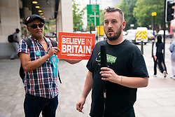 © Licensed to London News Pictures. 22/07/2019. London, UK. Pro-Brexit activist and yellow vest demonstrator James Goddard (right) leaves Westminster Magistrates' Court during a break in his sentencing case, after admitting to harassing pro-remain MP Anna Soubry by calling her a 'Nazi'. Photo credit : Tom Nicholson/LNP