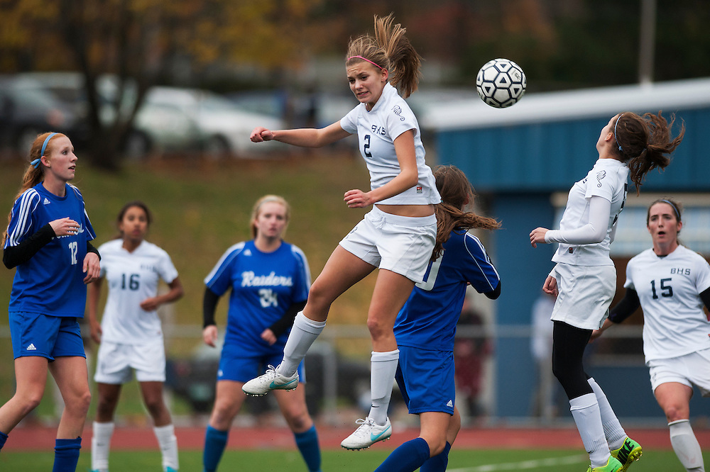 Burlington's Noe Musman (2) leaps to head the ball in front of the net during the girls playoff soccer game between the U-32 Raiders and the Burlington Sea Horses at Buck Hard Field on Friday afternoon October 24, 2014 in Burlington, Vermont (BRIAN JENKINS, for the Free Press)