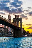 Manhattan Bridge at sunset, East River, New York, New York USA.