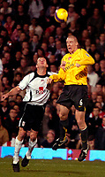 Photo: Ed Godden.<br /> Fulham v Arsenal. The Barclays Premiership. 29/11/2006.<br /> Arsenal's Philippe Senderos (R) heads the ball clear.