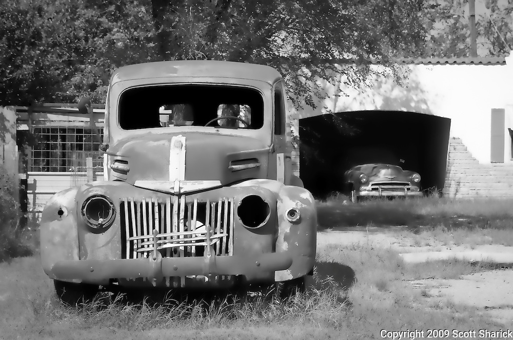 An abandoned truck in front of a garage on Route 66. Missoula Photographer