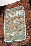 Old wall painted advert for Lacons brewery beer, Eye, Suffolk, England, UK