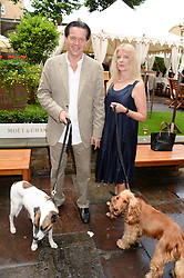 KEVIN O'SULLIVAN Sunday Mirror columnnist and his wife HENRIETTA with their dogs Chas & Dotty at the 6th Dogs Trust Honours held at Home House, Portman Square, London on 23rd July 2013.