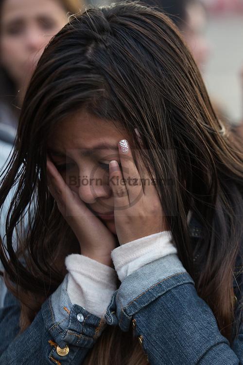 Bogota, Cundinamarca, Colombia - 02.10.2016        <br /> <br /> The Colombian capital Bogota after the failed peace contract referendum. Supporters of the peace treaty partly crying and embracing each other on the Plaza de Bolivar. In addition, heavy word conflicts with opponents of the peace treaty take place. The Colombian citizens voted tightly against the peace treaty negotiated between the government and the left FARC guerrilla. The FARC has been in war with the Colombian government for 52 years.<br />  <br /> Die kolumbianische Hauptstadt Bogota nach dem gescheiterten Friedensreferendum. Anhaenger des Friedensvertrags liegen sich teils weinend auf dem Plaza de Bolivar in den Armen. Mit Gegnern des Friedensvertrages kommt es zu heftigen Wortgefechten. Eine knappe Mehrheit der abstimmenden kolumbianischen Bevölkerung votierte gegen den ausgehandelte Friedensvertrag zwischen der Regierung und der linken FARC Guerilla. Die FARC befindet sich seit 52-Jahren im Krieg mit der kolumbianschen Regierung. <br /> <br /> Photo: Bjoern Kietzmann