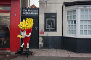 A cartoon character promotes chips outside the now vacant Britannia pub on 17th September 2016, on the Eastern Esplanade, at Southend, Essex, England. Southend-on-Sea is a seaside town on the north side of the Thames estuary 40 miles 64 km east of central London. In its heyday, the working class visited from the capital when train transport allowed them to enjoy its beaches and the worlds longest pier. Its splendour faded on the advent of package holidays to Spain etc.