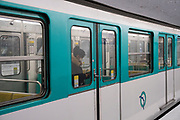 "March, 24th 2020 - Paris, Ile-de-France, France: Paris metro subways virtually empty to prevent the spread of the Coronavirus, during the ninth day of near total lockdown imposed in France. A week after President of France, Emmanuel Macron, said the citizens must stay at home from midday on Tuesday for at least 15 days. He said ""We are at war, a public health war, certainly but we are at war, against an invisible and elusive enemy"". All journeys outside the home unless justified for essential professional or health reasons are outlawed. Anyone flouting the new regulations is fined. Nigel Dickinson"
