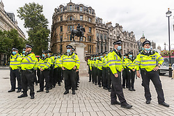 """Licensed to London News Pictures. 23/08/202. London, UK. A heavy police presence in Westminster as climate change protesters, Extinction Rebellion (XR), arrive in Trafalgar Square, London for the start of a 14 day protest with disruptive action and possible occupations of buildings and services. The protest, """"The Impossible Rebellion"""", want the government to implement their demand to stop all new fossil fuel investment immediately. Photo credit: Alex Lentati/LNP"""