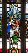 Nativity scene from stained glass window by Margaret Edith Aldrich Rope ( 1891-1988), Church of Saint Margaret, Leiston, Suffolk, England, UK