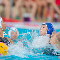 Sun Yujun of China (R) tries to block a hit by Rita Keszthelyi (L) of Hungary during the women waterpolo friendly match of Hungary and China in Tatabanya, Hungary on June 23, 2012. ATTILA VOLGYI