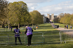 Community wardens from the Royal Borough of Windsor and Maidenhead erect railings beside the Long Walk in Windsor Great Park on the eve of the funeral of the Duke of Edinburgh on 16th April 2021 in Windsor, United Kingdom. The funeral of Prince Philip, Queen Elizabeth II's husband, will take place at St George's Chapel in Windsor Castle at 15:00 BST on 17th April, with the ceremony restricted to 30 mourners in accordance with current coronavirus restrictions.