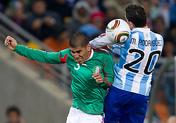 Carlos Salcido of Mexico vs Maxi Rodriguez of Argentina during the 2010 FIFA World Cup South Africa Round of Sixteen match between Argentina and Mexico at Soccer City Stadium on June 27, 2010 in Johannesburg, South Africa. Argentina defeated Mexico 3-1 and qualified for quarterfinals. (Photo by Vid Ponikvar / Sportida)