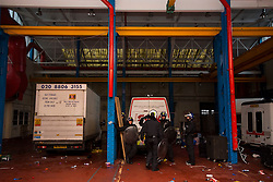 © Licensed to London News Pictures. 01/11/2015. London, UK. Root police inside the rave venue. The scene where Riot police clashed with party goers at the site of an illegal halloween rave in London where it has been reported that a petrol bomb was thrown. Photo credit: Ben Cawthra/LNP