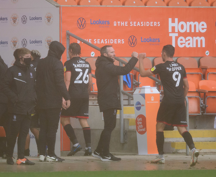 Lincoln City manager Michael Appleton, left, celebrates the late victory with Tom Hopper<br /> <br /> Photographer Chris Vaughan/CameraSport<br /> <br /> The EFL Sky Bet League One - Blackpool v Lincoln City - Saturday 3rd October 2020 - Bloomfield Road - Blackpool<br /> <br /> World Copyright © 2020 CameraSport. All rights reserved. 43 Linden Ave. Countesthorpe. Leicester. England. LE8 5PG - Tel: +44 (0) 116 277 4147 - admin@camerasport.com - www.camerasport.com