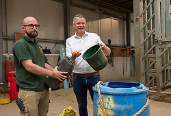 © Licensed to London News Pictures; 12/08/2021; Wraxall, UK. L-R: To mark World Elephant Day Labour's Shadow Environment Secretary LUKE POLLARD MP visits Noah's Ark Zoo Farm, here helping with food preparation, to warn that elephants are still being poached and ivory traded in the UK because Government Ministers have failed to protect them. It is over thirty months since the Ivory Act was passed in 2018, despite Michael Gove, the then Environment Secretary, saying it would be in force by the end of 2019. Ministers now say they want to extend the ivory ban to other ivory-bearing species (hippopotamus, narwhal, killer whale, sperm whale and walrus), but voted down Labour's amendment to do exactly that on 4th July 2018. Photo credit: Simon Chapman/LNP.