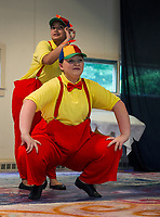 Tweedle Dee (Caitlyn Costa) and Tweedle Dum (Gabby Leclerc) during dress rehearsal for Alice in Wonderland with SKYT (Streetcar Kids Youth Theater) on Monday evening.  (Karen Bobotas/for the Laconia Daily Sun)