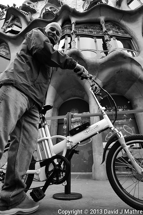 Xavi on His Bicycle in Front of Casa Batlló in Barcelona, Spain. Image taken with a Nikon 1 V1 and 6.7-13 mm VR lens (ISO 160, 6.7 mm, f/3.5, 1/400 sec)..