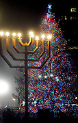 (Mara Lavitt — New Haven Register) <br /> December 5, 2013 New Haven<br /> A Chanukah menorah remained lit for the annual New Haven city tree lighting event on the Green.