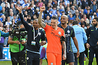 BRIGHTON, ENGLAND - MAY 12:  Ederson Moraes (31) of Manchester City celebrates wiining the Premier League at full time after a 4-1 win over Brighton during the Premier League match between Brighton & Hove Albion and Manchester City at American Express Community Stadium on May 12, 2019 in Brighton, United Kingdom. (MB Media)