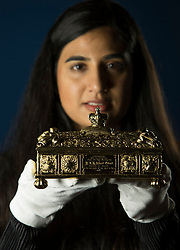 Works of art that brought the wonders of India to Britain at the end of the 19th century are to go on display in Scotland for the first time in over 130 years, in a new exhibition opening at The Queen's Gallery, Palace of Holyroodhouse on Friday, 15 December. Exploring the historic visit made by Albert Edward, Prince of Wales (later King Edward VII) at the end of the 19th century, Splendours of the Subcontinent: A Prince's Tour of India 1875–6 features some of the finest examples of Indian design and craftsmanship, presented to the Prince as part of the traditional exchange of gifts.<br /> <br /> Pictured:  A silver gilt address casket made by Edinburgh based goldsmiths Marshall & Sons. The casket is engraved with the Prince's name. Holding the piece is Curator of the exhibition, Kajal Meghani.