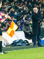 Football - 2016 / 2017 Premier League - Swansea City vs. Leicester City<br /> <br /> Leicester City manager Claudio Ranieri looks down, the linesman looks at his watch & Swansea fans celebrate in the background as the final whistle blows & Leicster lose n2-0, at The Liberty Stadium.<br /> <br /> COLORSPORT/WINSTON BYNOTH