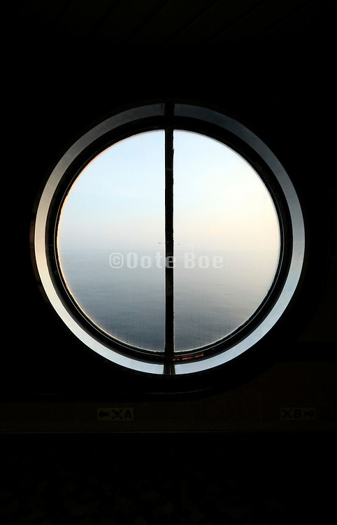 round window with view of the sea