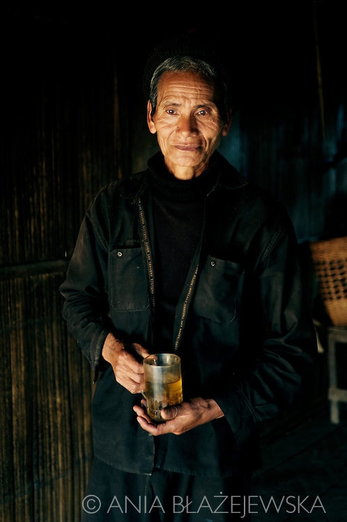 Burma/Myanmar. Man from the Akha tribe with a cup of tea.