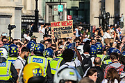 """Police clashed and arrested protestors during a """"Resist and Act for Freedom"""" protest against a mandatory coronavirus vaccine, wearing masks, social distancing and a second lockdown, nearby Canada House in Trafalgar Square, London on Saturday, Sept. 19, 2020. The event, which began at noon, drew a broad coalition including coronavirus sceptics, 5G conspiracy theorists and so-called """"anti-vaxxers"""". Speakers at the event accused the government of attempting to curtail civil liberties. (VXP Photo/ Vudi Xhymshiti)"""
