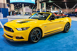 CHARLOTTE, NC, USA - November 11, 2015: Ford Mustang convertible on display during the 2015 Charlotte International Auto Show at the Charlotte Convention Center in downtown Charlotte.
