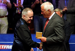 Runner up John Higgins (left) and Barry Hearn after the 2018 Betfred World Championship final at The Crucible, Sheffield.