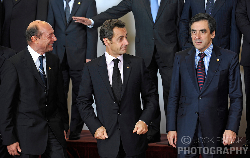 """Nicolas Sarkozy, France's president, center, , prepares for the """"Family Photo"""" session with Traian Basescu, Romania's president, left, and François Fillon, France's prime minister, right, at the European Summit, in Brussels, Belgium, Wednesday, Oct. 15, 2008.   (Photo © Jock Fistick)"""