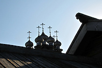 Wooden artistry on Kizhi Island, in Russia's Lake Onega, home to the world-famous Transfiguration Church, a timbered marvel with 22 onion domes built without a single nail. Over the years a number of other traditional wooden structures have been moved from Karelia to preserve them, and the island is now a UNESCO World Heritage site.