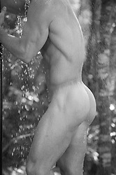 detail of a sexy nude man in an outdoor shower