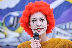© Licensed to London News Pictures. 04/09/2017. London, UK. A woman dressed as Ronald McDonald makes a speech as McDonald's staff and members of the Bakers Food and Allied Workers Union (BFAWU) attend a rally outside the Houses of Parliament in solidarity with McDonald's staff in Cambridge and Crayford who have gone on strike demanding an end to zero hours contracts and a minimum wage of GBP10 per hour.   Photo credit : Stephen Chung/LNP