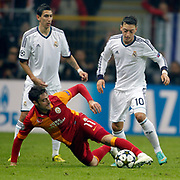 Galatasaray's Albert Riera Ortega (L) and Real Madrid's Mesut Ozil (R) during their UEFA Champions League Quarter-finals, Second leg match Galatasaray between Real Madrid at the TT Arena AliSamiYen Spor Kompleksi in Istanbul, Turkey on Tuesday 09 April 2013. Photo by Aykut AKICI/TURKPIX
