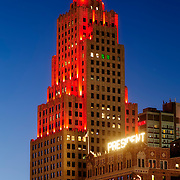 Power and Light Apartments in downtown Kansas City at dusk with LED lighting in Chiefs football red.