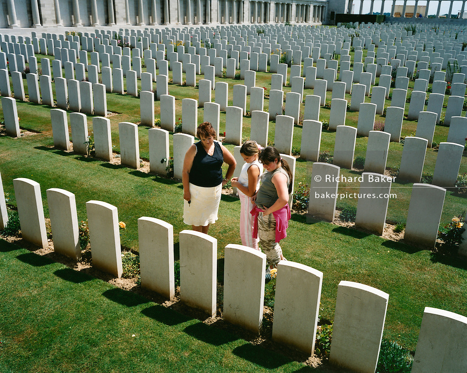 English visitors pay respects to commonwealth war dead at the Poziere cemetery near Albert, where those killed in the Battle of the Somme are buried or are rememberd..