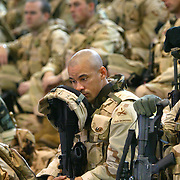 Sgt Tito Vazquez of Alpha Company 141, lower center, sat in the grandstands in Craig Gym at Ft. Riley during the deployment to Iraq for soldiers in the 3rd Brigade, 1st Armored Division. The soldiers were waiting to be processed and weighed with their battle gear for their charter flight from Topeka's Forbes Field en route to Iraq.