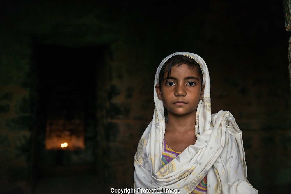 I met Babukhan and his daughter Mehak (pictured) while they went from grotto to grotto praying. They explained to me that they had been coming for 12 days to pray to the Djinn and their prayers had begun to come true.