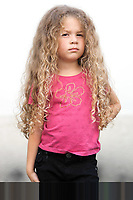 caucasian little girl portrait brat attitude isolated studio on white background