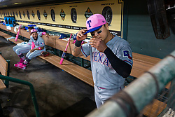 May 13, 2018 - Houston, TX, U.S. - HOUSTON, TX - MAY 13: Texas Rangers right fielder Shin-Soo Choo (17) adjust his hat in the dugout in the first inning during an MLB baseball game between the Houston Astros and the Texas Rangers, Sunday, May 13, 2018 in Houston, Texas. Houston Astros defeated Texas Rangers 6-1. (Photo by: Juan DeLeon/Icon Sportswire) (Credit Image: © Juan Deleon/Icon SMI via ZUMA Press)