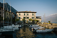 GARGNANO, ITALY - 19 APRIL 2018: The Bar Osteria al Porto di Villa is seen here by the harbor in Gargnano, Italy, on April 19th 2018.<br /> <br /> Lake Garda is the largest lake in Italy. It is a popular holiday location located in northern Italy, about halfway between Brescia and Verona, and between Venice and Milan on the edge of the Dolomites. The lake and its shoreline are divided between the provinces of Verona (to the south-east), Brescia (south-west), and Trentino (north).