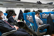 business people in the Shinkansen bullet train Japan