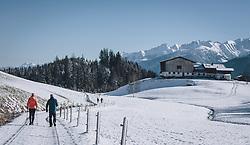 THEMENBILD - zwei Spaziergänger gehen auf einem schneebedecktem Weg, der durch eine unberührte Winterlandschaft führt. Im Hintergrund ein großer Bauernhof, Nadelbäume und die Hohen Tauern. Das Naturdenkmal Wasenmoos lädt auch im Winter zu ausgedehnten Wanderungen in den Kitzbüheler Alpen ein, aufgenommen am 21. November 2020 in Mittersill, Oesterreich // two walkers walk along a snow-covered path that leads through an untouched winter landscape. In the background a large farm, conifers and the Hohe Tauern mountains. The natural monument Wasenmoos invites you also in winter to extensive hikes in the Kitzbüheler Alps, in Mittersill, Austria on 2020/11/21. EXPA Pictures © 2020, PhotoCredit: EXPA/Stefanie Oberhauser