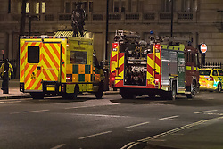 Victoria Embankment, London, January 19th 2017. Bomb disposal experts from the Royal Navy at Victoria Embankment to defuse and remove an unexploded bomb discovered,  between Hungerford Bridge and Westminster Bridge, near the Houses of Parliament, by engineers working in the River Thames. PICTURED: Fire and ambulance services on standby near the scene.