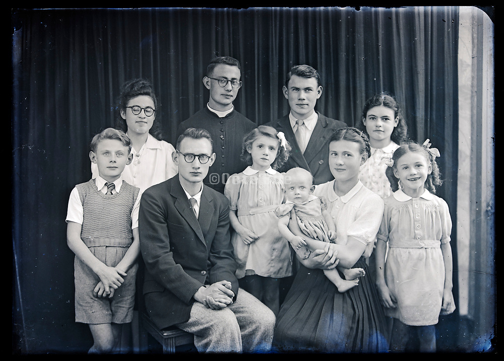 large family group studio portrait without parents France circa 1930s