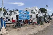 A sign near the entrance of the Moria refugee camp says that the camp has cost almost 5.5 million euros. Moria camp, Lesvos island, Greece.