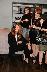 Left to right, TRINNY WOODALL, MARIE HELVIN and KATHY LETTE at a reception to launch the range of Dr Lancer beauty products held at The Penthouse, Harrods, Knightsbridge, London on 16th September 2013.