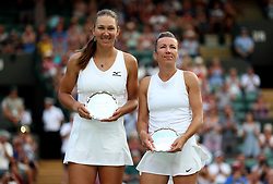 Ladies Doubles runners up Nicole Melichar and Kveta Peschke (right) on day twelve of the Wimbledon Championships at the All England Lawn Tennis and Croquet Club, Wimbledon. PRESS ASSOCIATION Photo. Picture date: Saturday July 14, 2018. See PA story TENNIS Wimbledon. Photo credit should read: Nigel French/PA Wire. RESTRICTIONS: Editorial use only. No commercial use without prior written consent of the AELTC. Still image use only - no moving images to emulate broadcast. No superimposing or removal of sponsor/ad logos. Call +44 (0)1158 447447 for further information.